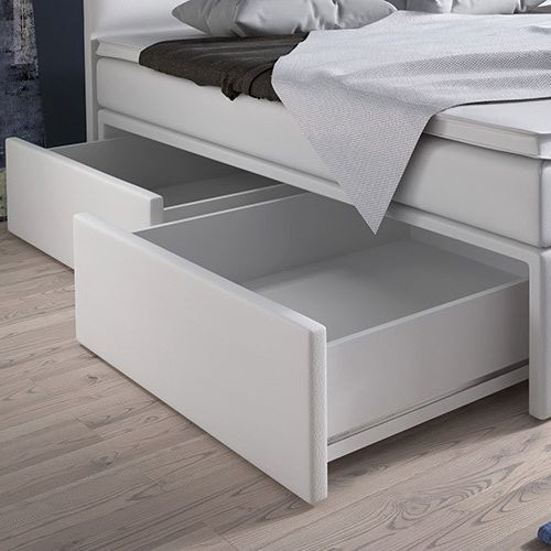 szuflady po bokach łoża (wysuwane z lewej)